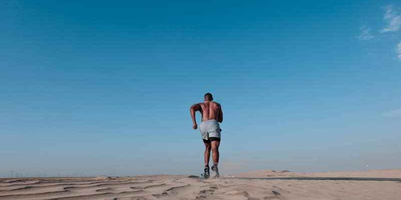 Canva - Photo of Topless Man Running on Sand (1)